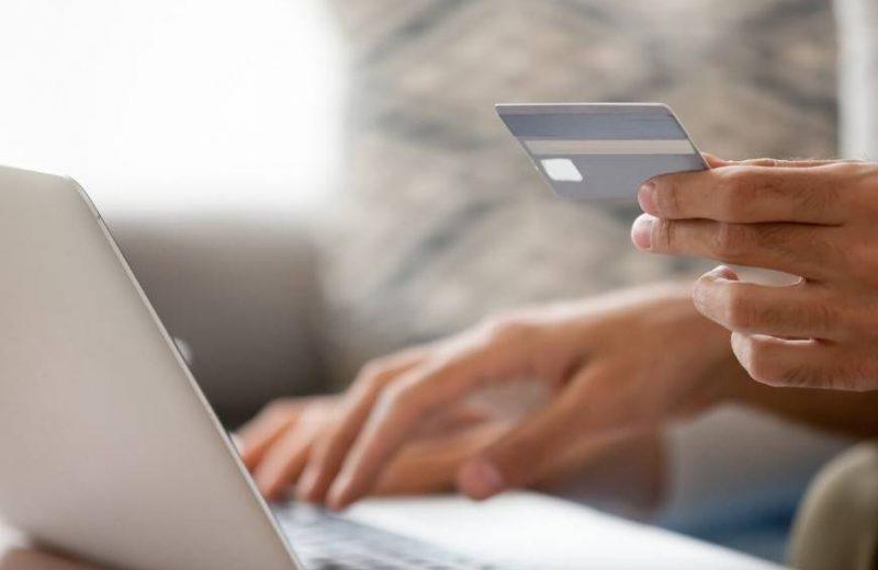 Person entering information from credit card due to scams